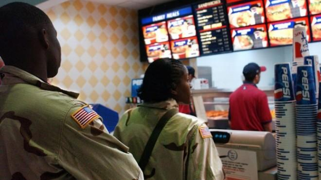 Members of the U.S. Army at a food court: While these soldiers look rather fit, some of their colleagues are struggling to stay in shape.