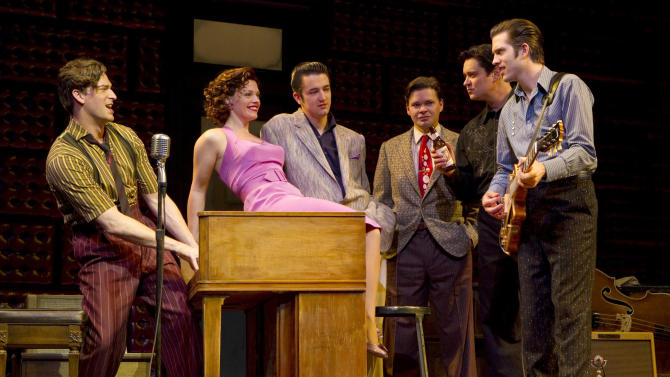 """FILE - In this undated theater publicity image released by Boneau/Bryan-Brown, from left, Levi Kreis, Elizabeth Stanley, Eddie Clendening, Hunter Foster, Lance Guest and Robert Britton Lyons are shown in a scene from the musical """"Million Dollar Quartet,"""" at Broadway's Nederlander Theatre in New York. On May 24, 2012, the producers announced that the final performance for """"Million Dollar Quartet,"""" currently off-Broadway at New World Stages, will be on June 24. (AP Photo/Boneau/Bryan-Brown, Joan Marcus, File)"""