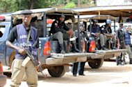 Policemen sits in their vehicles in Jos, Plateau State on March 10, 2010. Attackers in Nigeria including some dressed as soldiers have killed 10 members of the same family with half of the victims under the age of six, an official in central Plateau state said