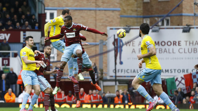 Crystal Palace's Glenn Murray, third left, heads in a goal during the English Premier League soccer match between West Ham United and Crystal Palace at the Boleyn Ground in London, Saturday, Feb. 28, 2015. (AP Photo/Kirsty Wigglesworth)
