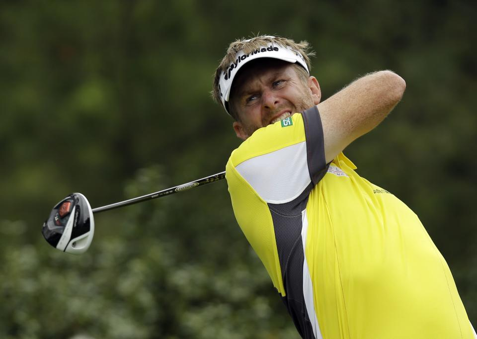 David Lynn, of England, tees off at the 15th hole during the first round of the Masters golf tournament Thursday, April 11, 2013, in Augusta, Ga. (AP Photo/David J. Phillip)