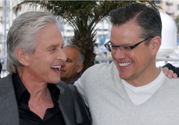 "Cast members Michael Douglas and Matt Damon pose during a photocall for the film ""Behind the Candelabra"" at the 66th Cannes Film Festival in Cannes"