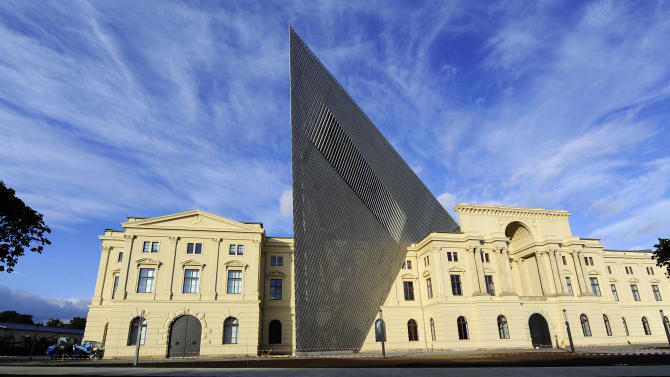 The Saturday, Oct. 8, 2011 photo shows Dresden's, eastern Germany, Museum of Military History that is to be reopened after a dramatic redesign by American architect Daniel Libeskind. Libeskind added a massive five-story wedge of glass, concrete and steel that rips through the former armory built for the armies of Kaiser Wilhelm I, interrupting the symmetry of the neo-Classical building as a symbol of how German democracy has pushed aside the authoritarian past. (AP Photo/dapd, Matthias Rietschel)