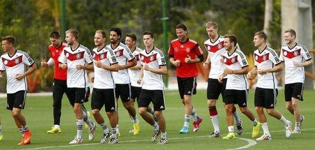 Germany's national soccer team players run during a training session in the village of Santo Andre