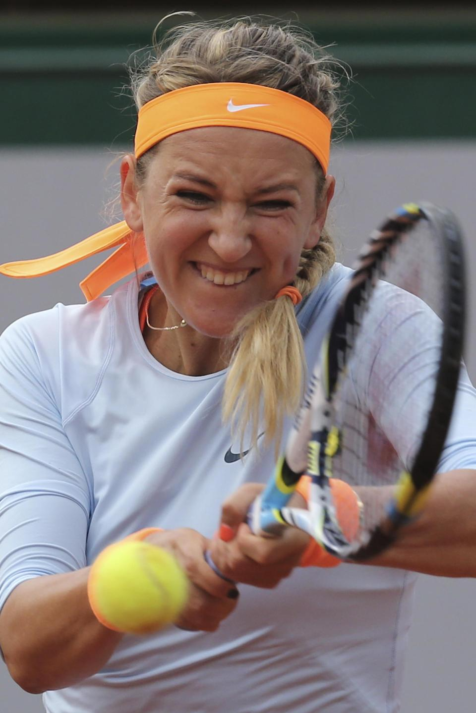 Victoria Azarenka of Belarus returns against Italy's Francesca Schiavone in their fourth round match at the French Open tennis tournament, at Roland Garros stadium in Paris, Monday June 3, 2013. Azarenka won in two sets 6-3, 6-0. (AP Photo/Michel Euler)