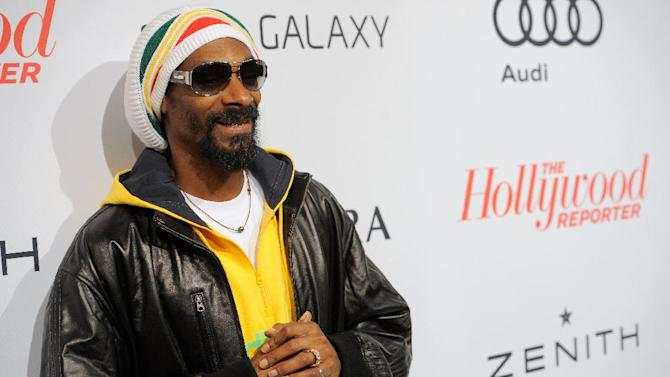 Snoop Dogg, aka Snoop Lion, arrives at The Hollywood Reporter Nominees' Night at Spago on Monday, Feb. 4, 2013, in Beverly Hills, Calif. (Photo by Chris Pizzello/Invision for The Hollywood Reporter/AP Images)