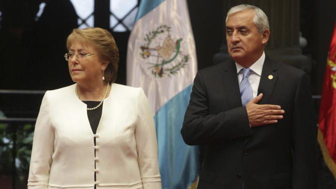 Chile's President Bachelet stands with Guatemala's President Perez during a welcoming ceremony in the presidential palace in Guatemala City