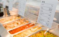 Detailed nutritional information is displayed above the food available at the London 2012 Olympic Athletes&#39; Village in the Olympic Park in east London, on July 12. Feeding 10,500 athletes and millions of fans during the Olympics may be a mammoth task but London 2012 is hoping to seize the opportunity to also improve the reputation of British cuisine