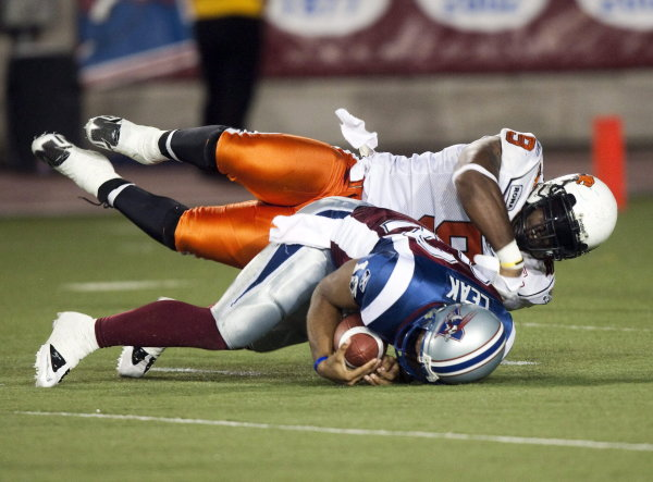 Montreal Alouettes quarterback Chris Leak is sacked by B.C. Lions' Keron Williams during first quarter Canadian Football League action Friday, Septemb...