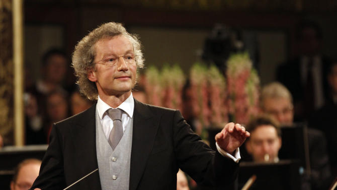 Austrian maestro Franz Welser-Moest conducts the Vienna Philharmonic Orchestra during the traditional New Year's concert at the Golden Hall of the Musikverein in Vienna, Austria, Tuesday, Jan. 1, 2013. The concert is being broadcast to over 80 countries around the globe. (AP Photo/Ronald Zak)