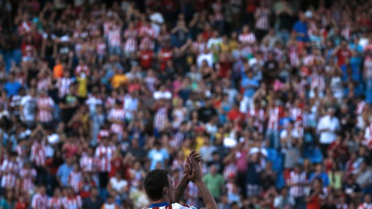 Atletico Madrid's newly signed player, Croatian Mario Mandzukic, waves to the fans during a media presentation at the Vicente Calderon stadium in Madrid