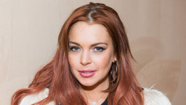 Lindsay Lohan attends Lonneke Engel And Valentina Zelyaeva Organice Your Life Annual Holiday Party at Time Warner Building on December 14, 2012 in New York City -- Getty Premium