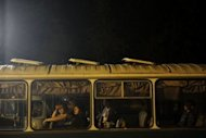 Victims of the floods rest in the a bus in Krymsk. Flash floods deluged Russia&#39;s southern Krasnodar, killing at least 134 people in the region&#39;s worst natural disaster in decades, officials and witnesses said Saturday