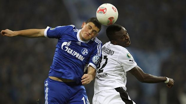 Schalke 04's Kyriakos Papadopoulos and Sandhausen's Kingsley Onuegbu (R) head a ball during their German DFB Cup tie (Reuters)