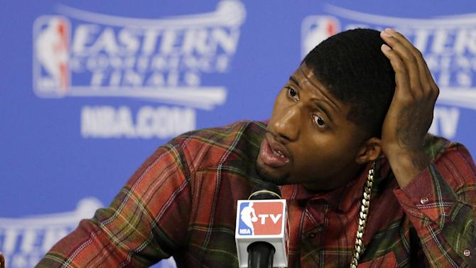 Indiana Pacers forward Paul George speaks during the post-game news conference after Game 4 in the NBA basketball Eastern Conference finals playoff series, Tuesday, May 27, 2014, in Miami. The Heat won 102-90