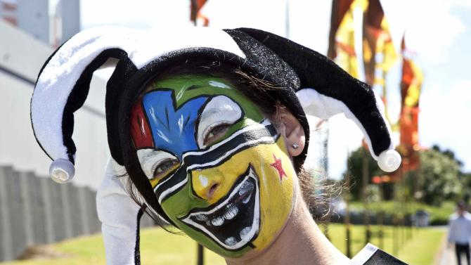 A fan with a painted face is seen outside Eden Park before the Cricket World Cup match between Australia and New Zealand in Auckland