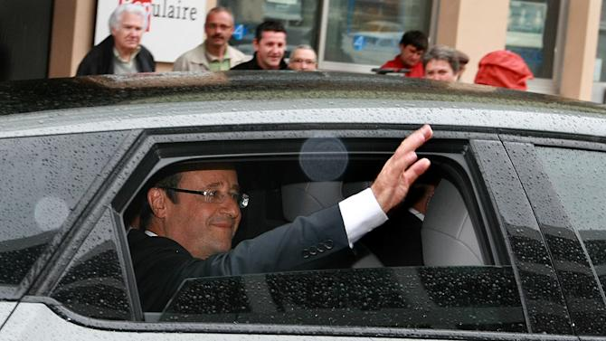 French President Francois Hollande leaves the polling station after voting for the first round in the french parliamentary election in Tulle, central France, Sunday, June 10, 2012. French voters are going to the polls in elections for the lower house of parliament, which will determine whether new President Francois Hollande's Socialists or rival conservatives control the government. (AP Photo/Bob Edme)