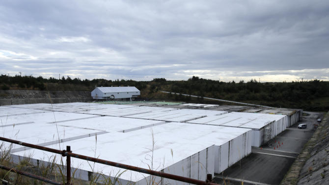 """This Nov. 8, 2012 photo shows the low-level radioactive waste disposal center, a part of the Rokkasho spent nuclear fuel reprocessing plant facilities, run by Japan Nuclear Fuel Ltd., in Rokkasho village in Aomori Prefecture, northern Japan. By hosting a high-tech facility that would convert spent fuel into a plutonium-uranium mix designed for the next generation of reactors, Rokkasho was supposed to provide fuel while minimizing nuclear waste storage problems. Those ambitions are falling apart because years of attempts to build a """"fast breeder"""" reactor, which would use the reprocessed fuel, appear to be ending in failure.  (AP Photo/Koji Sasahara)"""