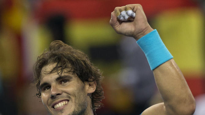 Spain's Rafael Nadal celebrates after defeating Switzerland's Stanislas Wawrinka during a quarterfinal match for the Shanghai Masters tennis tournament at the Qizhong Forest Sports City Tennis Center in Shanghai, China on Friday, Oct. 11, 2013. Nadal won 7-6, 6-1. (AP Photo/Ng Han Guan)