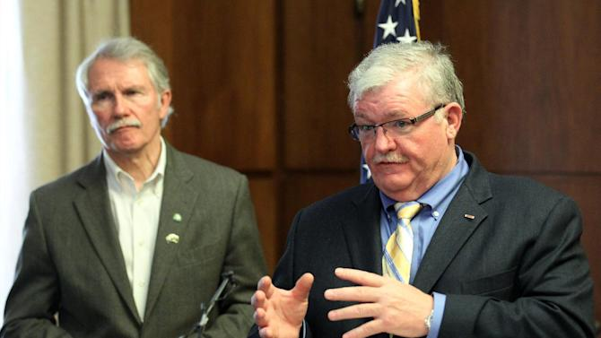 General Mike Caldwell, right, gestures as Gov. John Kitzhaber looks on during a news conference Thursday, June 28, 2012, in Salem, Ore. Caldwell is interim director of the Oregon Office of Emergency Management. Residents and tourists on the Oregon coast will soon have a quick and easy way to report debris from the Japanese tsunami. Kitzhaber announced Thursday that people will be able to call 211 to report tsunami debris. Beginning Friday, the hotline will be staffed during business hours and will take recorded messages at other times.  (AP Photo/Rick Bowmer)