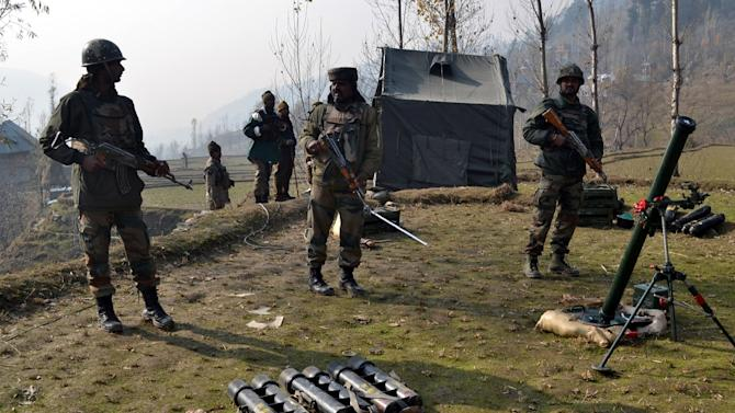 Indian army soldiers prepare to fire mortar shells towards hiding suspected militants in the Maniga area of Kupwara district north of Srinagar on November 23, 2015