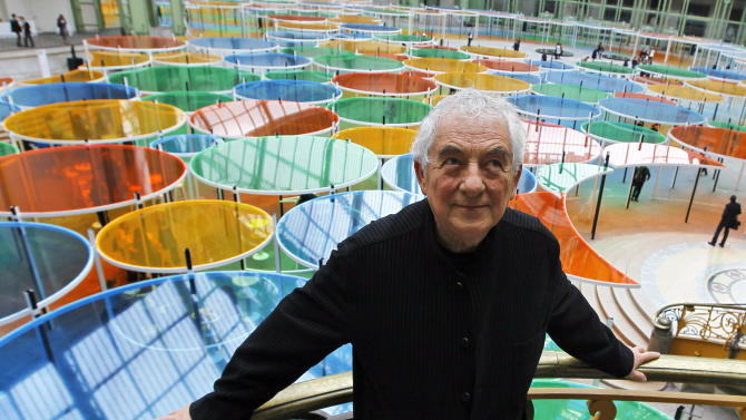 """Contemporary artist Daniel Buren poses in the Grand Palais during the opening of ground-breaking Monumenta exhibit in Paris, Wednesday May 9, 2012. Monumenta, the hugely-popular annual installation project that's in its fifth year, dares an artist of international statue to """"move into"""" the nave of one of the French capital's most monumentus buildings, and own it. (AP Photo/Francois Mori)"""