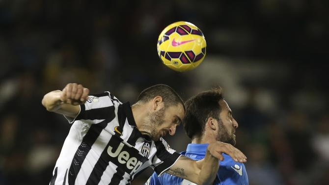 Juventus Leonardo Bonucci fights for the ball with Napoli's Gonzalo Higuain during their Italian Super Cup soccer match  at Al-Sadd Stadium, in Doha