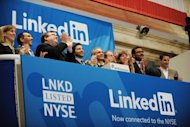 Linkedin founder Reid Garrett Hoffman (C) and CEO Jeff Weiner (2nd R) at the ringing of the opening bell of the New York Stock Exchange in 2011 during the initial public offering of the company. offman, an early investor in Facebook who sold some of his stake in the company when it went public, said that he seldom checks his own firm&#39;s stock price preferring to focus on building the business