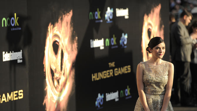 """Actress Isabelle Fuhrman arrives at the world premiere of """"The Hunger Games"""" on Monday, March 12, 2012 in Los Angeles. (AP Photo/Chris Pizzello)"""
