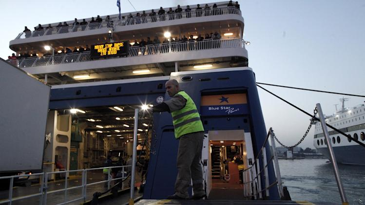 A ferry crewman stands on a rising gangplank as his ship prepares to sail for the Cyclades islands, at the Greek capital's port of Piraeus, after striking seamen were forced to return to work early Wednesday, Feb. 6, 2013. Greece's conservative-led government used emergency powers late Tuesday to order the strikers back to work after a six-day walkout to protest pay arrears of over six months, benefit cuts and austerity measures. (AP Photo/Petros Giannakouris)