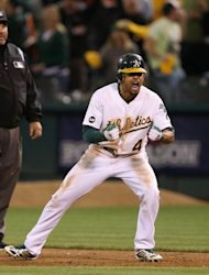 Oakland Athletics' Coco Crisp celebrates after hitting a game-winning single to beat the Detroit Tigers on October 9. The A's scored three runs in the ninth to defeat Detroit 4-3 and level their best-of-five battle at 2-2, setting up a one-game showdown to advance on Thursday