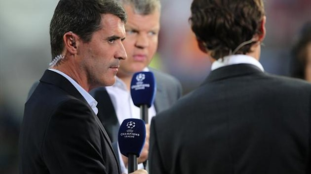 Former Manchester United captain Roy Keane speaks to Adrian Chiles and Gareth Southgate ,ITV commentators (PA Photos)