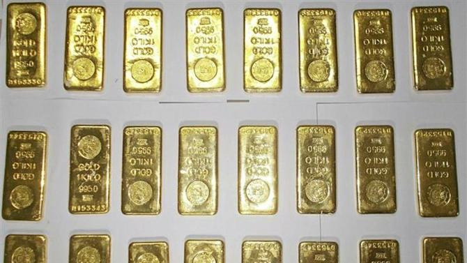 Seized gold bars are kept on displayed by custom officers at the international airport in Kolkata November 19, 2013.