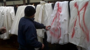 Priscilla of Boston employees spray-painted designer wedding gowns so they couldn't be worn. Photo courtesy of KARE/CNN