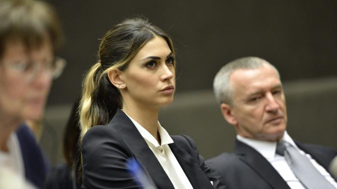 Melissa Satta, center, fiancee of Ghana's soccer player  Kevin-Prince Boateng, attends a panel discussion on Racism and Sport during the World Humanitarian Day at the European headquarters of the United Nations in Geneva, Switzerland, Thursday, March 21, 2013.  (AP Photo/Keystone/Martial Trezzini)