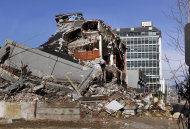In this photo taken Friday, July 8, 2011, a building is destroyed in downtown Christchurch, New Zealand. Christchurch is the disaster that the world forgot. When the deadly quake toppled the iconic Cathedral spire and flattened buildings in this city of 390,000, people around the globe paid attention. But two weeks later, the massive earthquake and tsunami that killed more than 20,000 in Japan took center stage. (AP Photo/Martin Hunter)