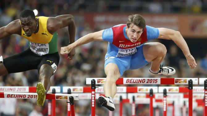 hubenkov of Russia and Parchment of Jamaica to win the men's 110m hurdles during the 15th IAAF World Championships at the National Stadium in Beijing