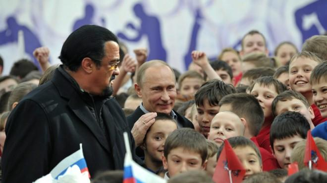 Russian President Vladimir Putin and Steven Seagal tour a new sports arena in Moscow on March 13.