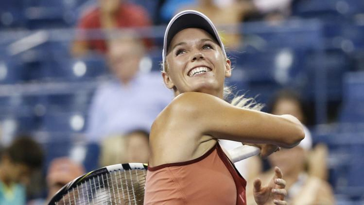 Caroline Wozniacki of Denmark celebrates defeating Sara Errani of Italy in their women's quarter-finals singles match at the 2014 U.S. Open tennis tournament in New York