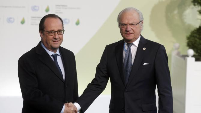 French President Hollande welcomes Sweden's King Gustav as he arrives for the opening day of the World Climate Change Conference 2015 (COP21) at Le Bourget