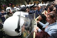 <p>Greek riot police scuffle with anti-austerity demonstrators in Thessaloniki on Saturday. Greece has completed 60 percent of the reforms already demanded of it, a study reportedly says.</p>