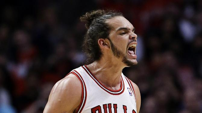Chicago Bulls center Joakim Noah reacts after scoring a basket and a free throw during the first half in Game 6 of their first-round NBA basketball playoff series against the Brooklyn Nets in Chicago, Thursday, May 2, 2013. (AP Photo/Nam Y. Huh)