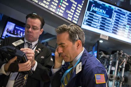 Wall Street ends down after data; posts strong gains for month