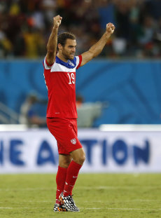 Graham Zusi celebrates after his team's 2-1 victory over Ghana. (AP)