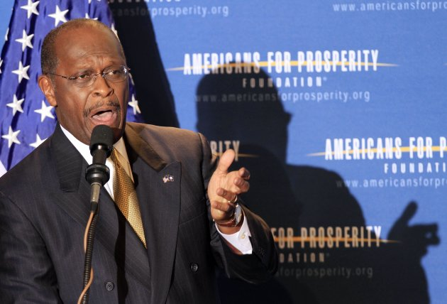 FILE - Republican businessman Herman Cain speaks during a dinner sponsored by Americans for Prosperity, in this April 29, 2011 file photo taken in Manchester , N.H. Cain casts himself as the outsider, the pizza magnate with real-world experience who&#39;ll bring fresh ideas to the nation&#39;s capital. But Cain&#39;s economic ideas, support and organization have close ties to two billionaire brothers who bankroll right-leaning causes through their group Americans for Prosperity. (AP Photo/Jim Cole, File)