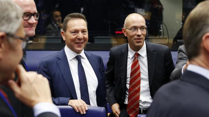 Greece's Finance Minister Stournaras and ECB Executive Board Member Asmussen attend a eurozone finance ministers meeting in Luxembourg