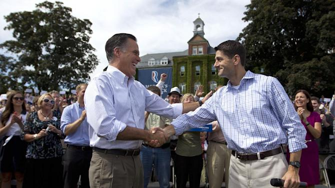 Republican presidential candidate, former Massachusetts Gov. Mitt Romney shakes hands with his vice presidential running mate Rep. Paul Ryan, R-Wis., during a campaign rally, Monday, Aug. 20, 2012, in Manchester N.H.  (AP Photo/Evan Vucci)
