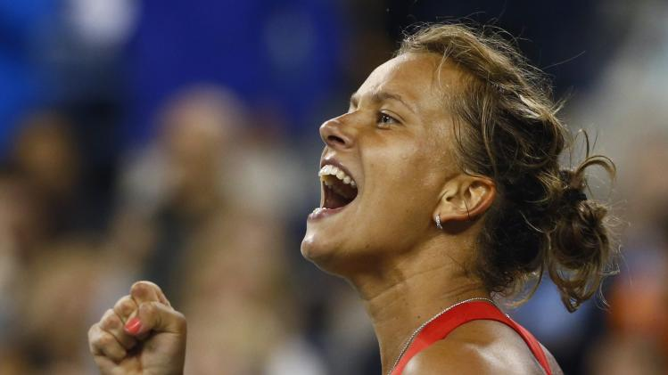 Barbora Zahlavova Strycova of the Czech Republic celebrates winning a second set tie-break against Eugenie Bouchard of Canada during their women's single match at the 2014 U.S. Open tennis tournament in New York