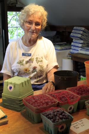Irma Goodrich stands at the counter of her Salt Box Farm Wednesday, July 18, 2012 in Stratham, N.H. Goodrich runs a small pick your own farm and last year,  was so upset that people consumed or walked away with blueberries without paying for them that she closed the farm stand earlier than usual. (AP Photo/Jim Cole)
