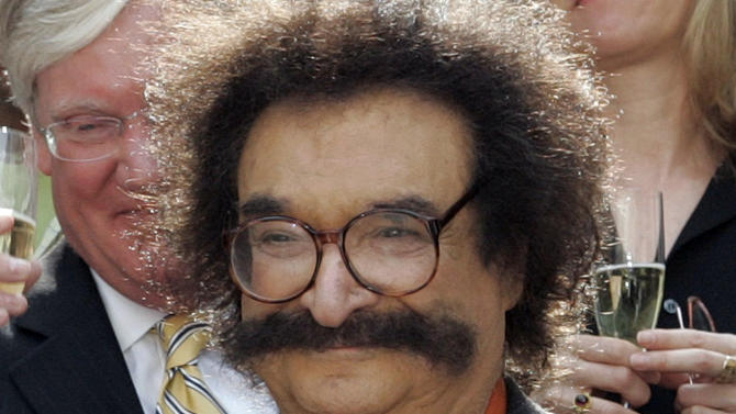 """FILE - In this May 31, 2006 file photo, film critic Gene Shalit is seen during a toast with """"Today"""" show cast and crew at the end of Katie Couric's final show, in New York. A misdemeanor driving charge against retired television movie critic Gene Shalit is set to be dismissed in Massachusetts. The hearing was continued to April 2, when the driving to endanger charge will be dismissed.  (AP Photo/Richard Drew, File)"""